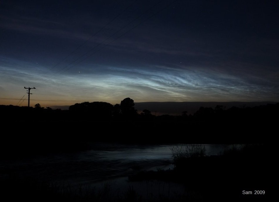 Noctilucent clouds 2009 over lake
