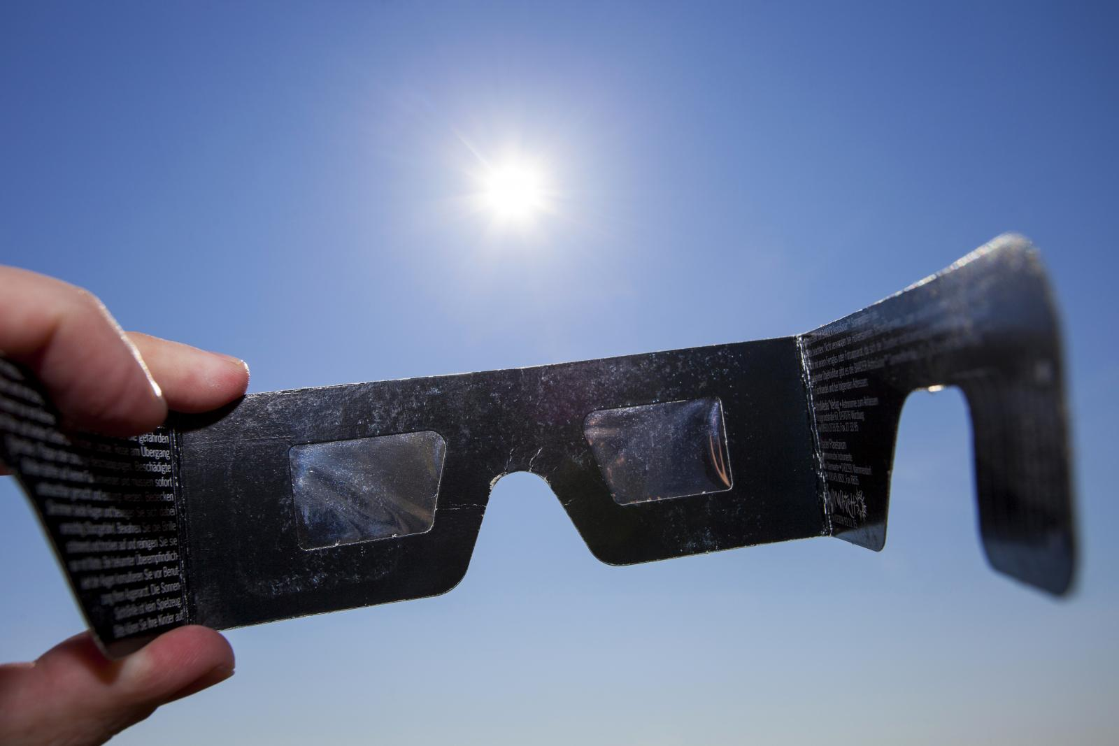 Use eclipse glasses or project the suns image onto a piece of paper to view the solar eclipse