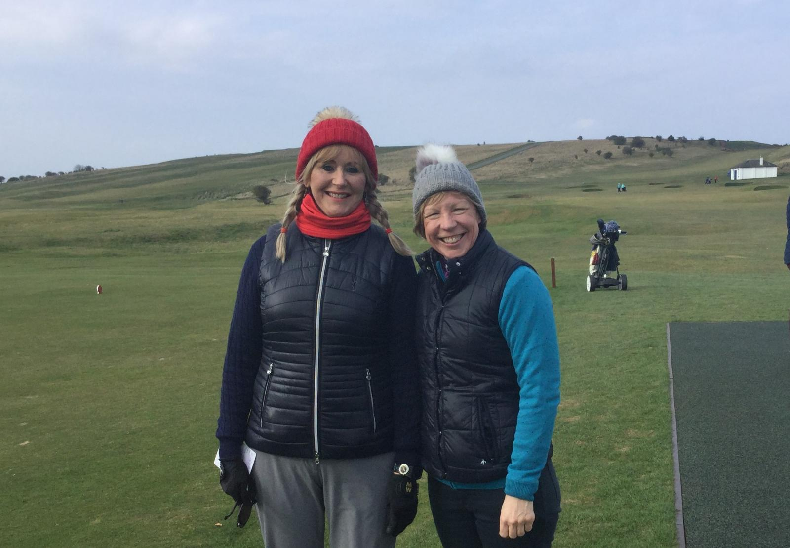 Dressed for the weather, two Gullane golfers in hats and coats