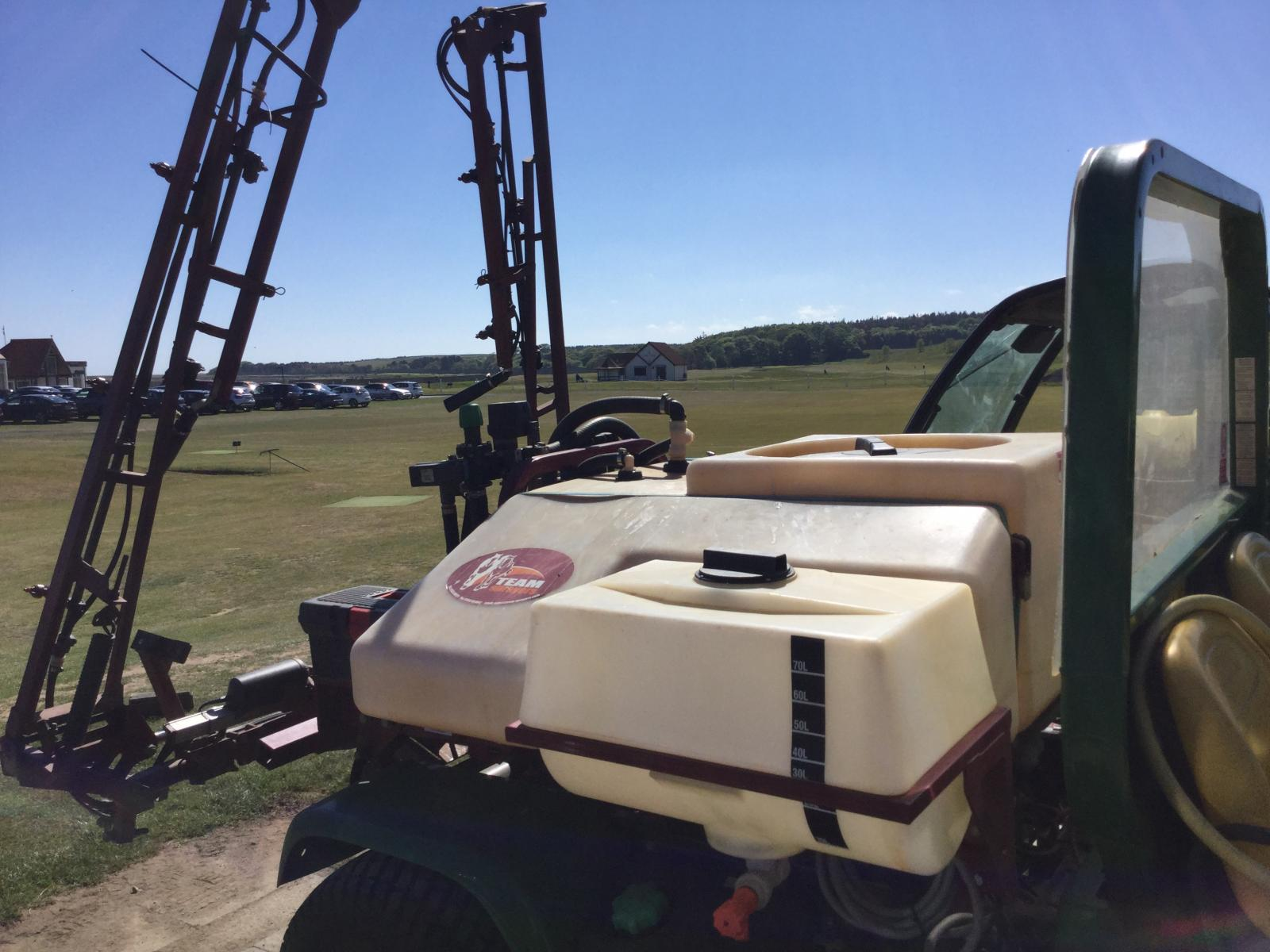 Golf course spraying machine